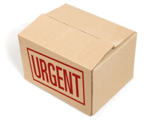 "Package in cardboard box with ""Urgent"" in red on front"